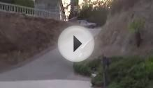 Stupid Kid falls off bike going downhill